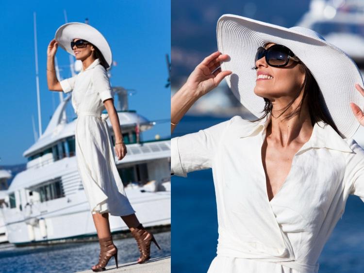 5 modele de rochii albe pentru vara 2018 - femeie la mare langa un iaht